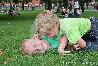 Children play in grass