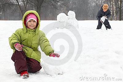 Children play on outdoor in winter Stock Photo