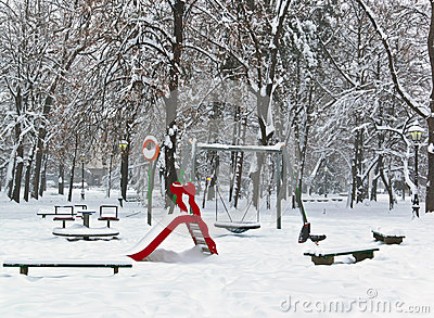 Children playground equipment park in winter