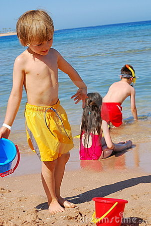 Free Children Playing At The Beach Royalty Free Stock Photo - 2605075