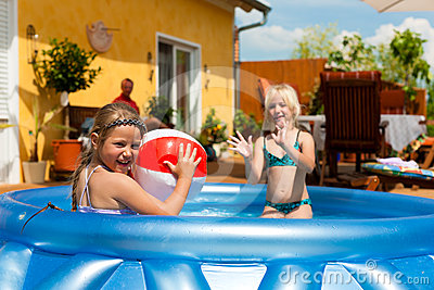 Children Playing With Ball In Water Pool Stock Photography - Image: 24464272