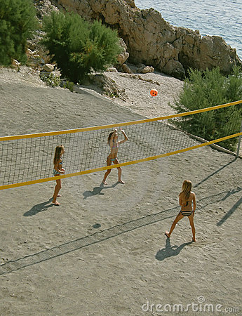 Children playing beach volleyball