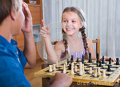 Children playing chess at home Stock Photo