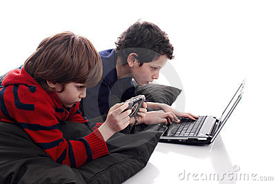 Children playing computer and video games
