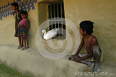 Children playing with a duck Editorial Stock Photo
