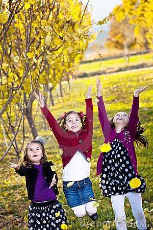 Children playing in the fall leaves