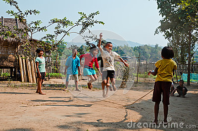 Children playing Kra Dod Cheark (the rope jumpin Editorial Photography