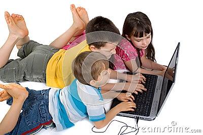 Children playing at laptop computer