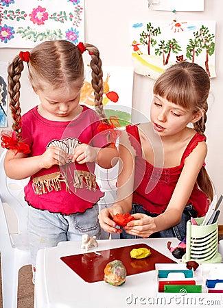 Children  playing with plasticine.