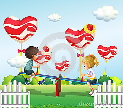 Children playing with the seesaw in the playground