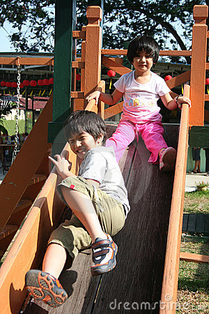 Children playing slide