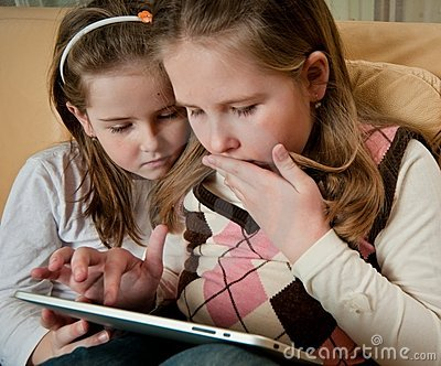 Children playing with tablet