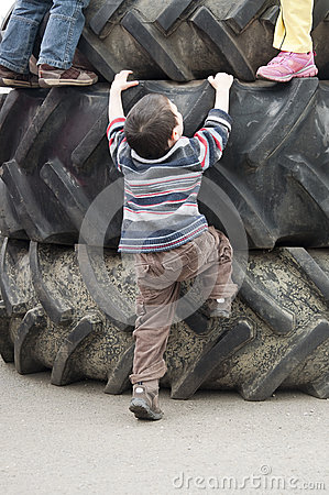Children playing on tires