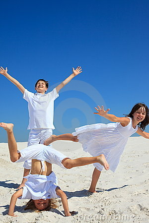Children playing on white sand