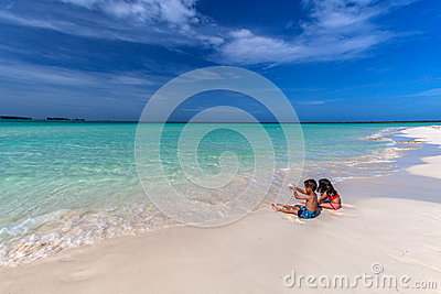 Stock photos children playing on white sandy cuban beach in cayo coco
