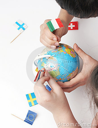 Free Children Pointing Flags On World Globe Stock Photo - 4093100