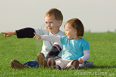 Children pointing outdoors