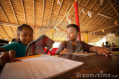 Children from poor areas at school Editorial Stock Image