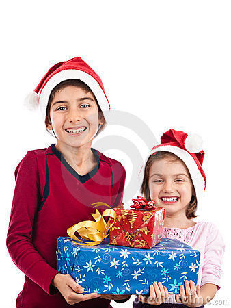 Children with presents posing at Christmas isolate