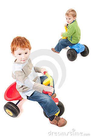 Children riding kids boys tricycles