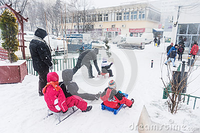 Children riding sleighs in Bucharest Editorial Image