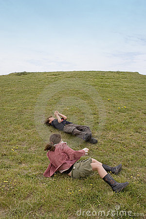 Children Rolling Down Hill Royalty Free Stock Photos