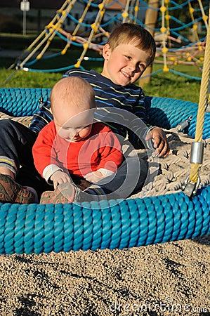 Children on round swing