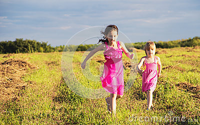 Girls running in countryside