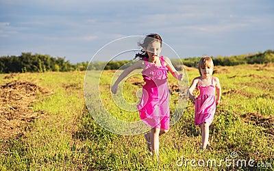 Girls running in countryside