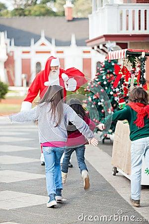 Children Running To Embrace Santa Claus