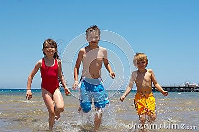 Children running in water