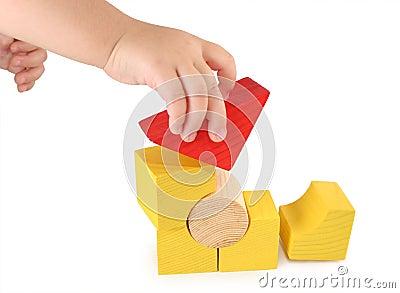 Children s hand holds  cube