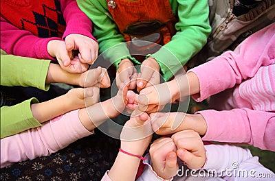 Children s hands show sign ok, top view