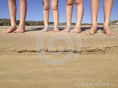 Children s legs on beach