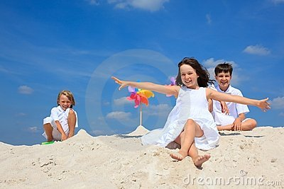 Children in sand on beach