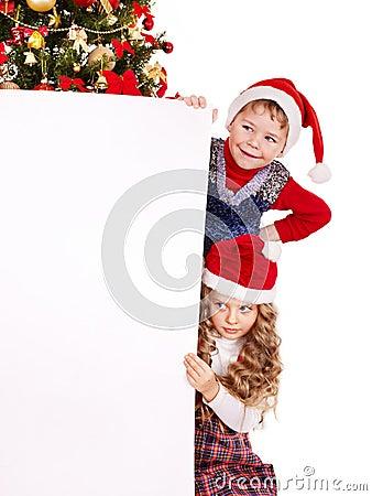 Children in Santa hat with banner .