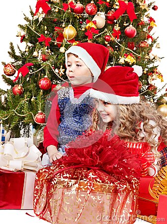 Children in Santa hat with gift box.