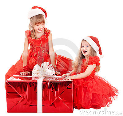 Children in santa hat holding gift box.