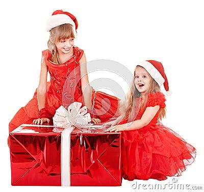 Children in santa hat holding gift box.