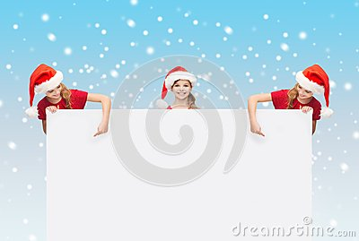 Children in santa helper hats with blank board