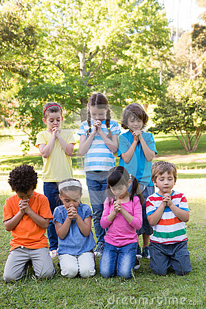 Free Children Saying Their Prayers In Park Royalty Free Stock Images - 49900169