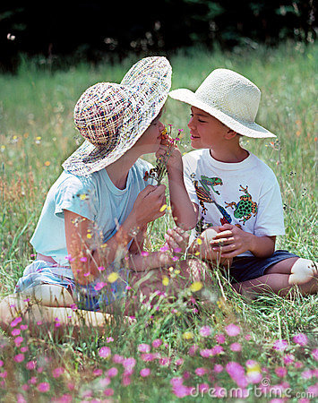 Children sharing flowers