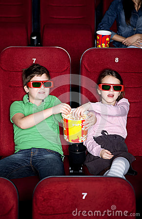 Free Children Sharing Popcorn Royalty Free Stock Photo - 24812795