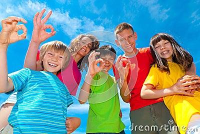 Children showing ok sign