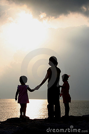 Children Silhouetted at Sunset