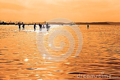 Children silhouettes playing in Balaton Lake