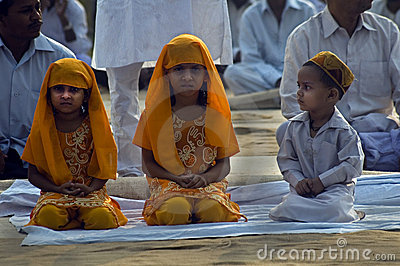 Children sitting at Id prayers Editorial Stock Image