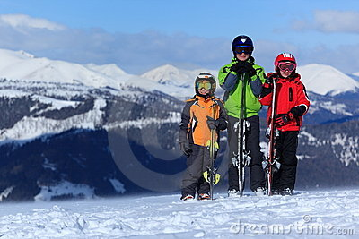 Children with skis on mountain