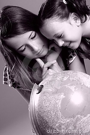 Children studying globe