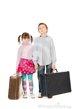 Children with suitcases